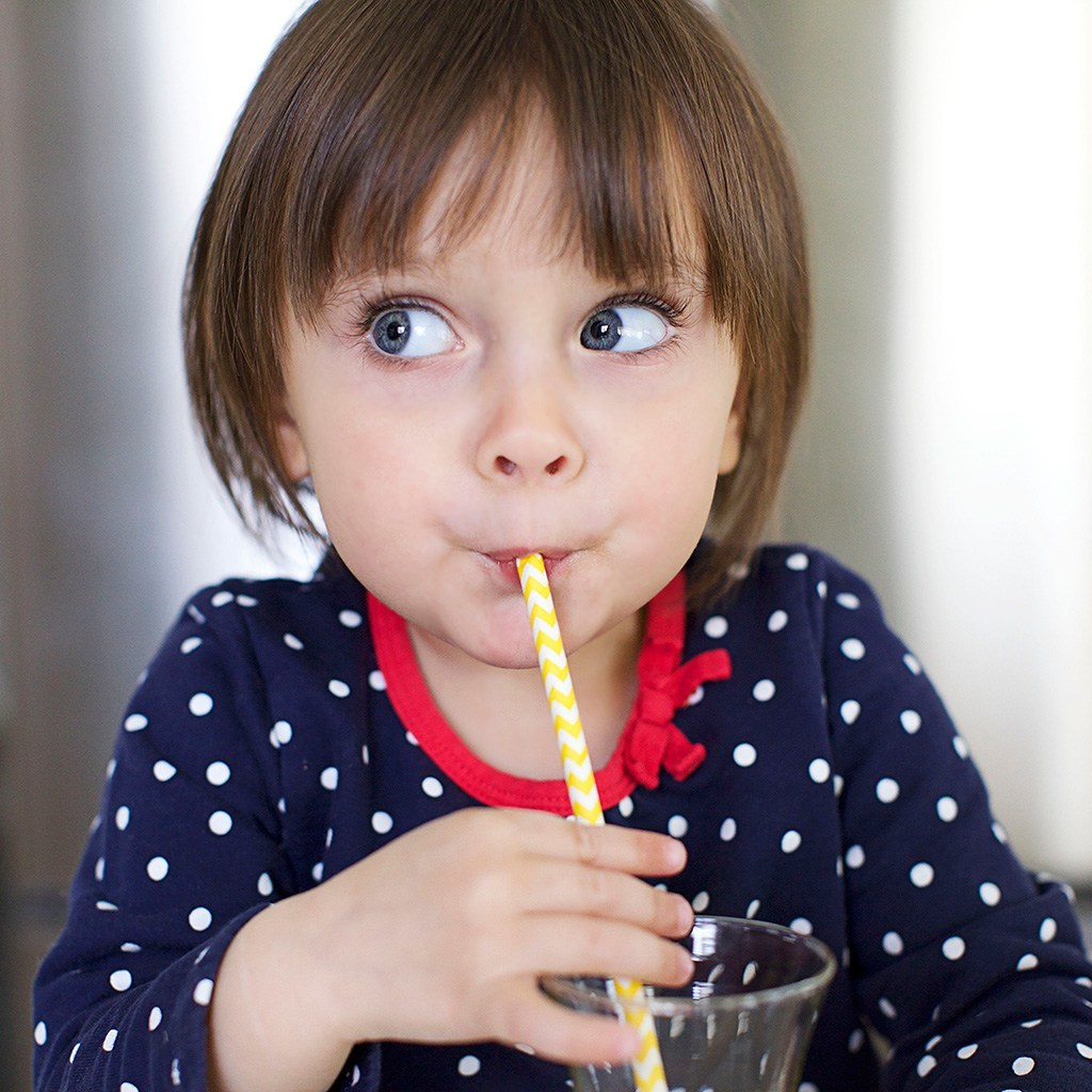 Girl Drinking with Straw